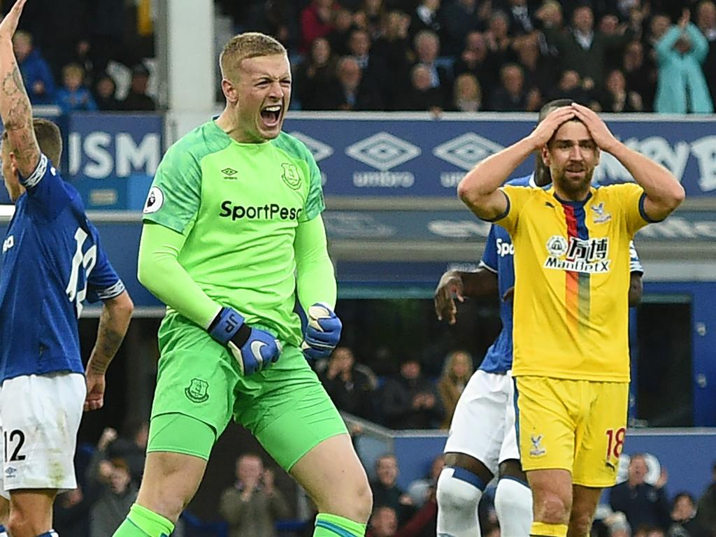 Everton's English goalkeeper Jordan Pickford (2nd L) reacts after saving a penalty taken by Crystal Palace's Serbian midfielder Luka Milivojevic (not pictured) during the English Premier League football match between Everton and Crystal Palace at Goodison Park in Liverpool, north west England on October 21, 2018. (Photo by Oli SCARFF / AFP) / RESTRICTED TO EDITORIAL USE. No use with unauthorized audio, video, data, fixture lists, club/league logos or 'live' services. Online in-match use limited to 120 images. An additional 40 images may be used in extra time. No video emulation. Social media in-match use limited to 120 images. An additional 40 images may be used in extra time. No use in betting publications, games or single club/league/player publications. /