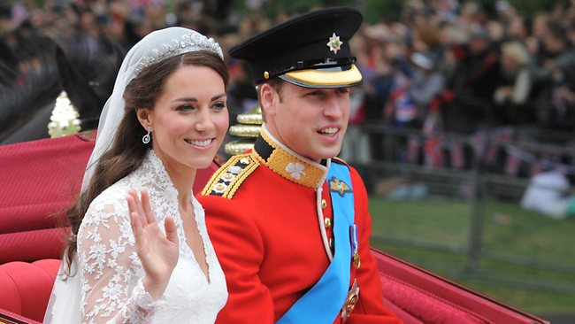 Prince William, Duke of Cambridge and Catherine, Duchess of Cambridge make the journey by carriage procession to Buckingham Palace past crowds of spectators following their marriage at Westminster Abbey on April 29, 2011.
