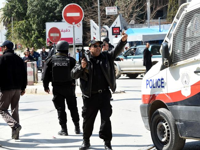 Taking control ... Tunisian security forces secure the area after gunmen attacked the museum. Picture: AFP/ Fethi Belaid