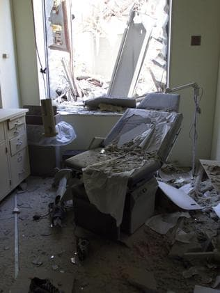 Debris is seen in a dentist's office on a block opposite New York's WTC five days after the attack. Picture: Steve Wood