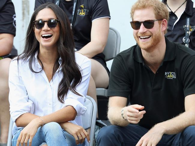 "Misha Nonoo's ""husband"" shirt on Meghan at her first public outing with Prince Harry, Picture: Chris Jackson/Getty Images for the Invictus Games Foundation."