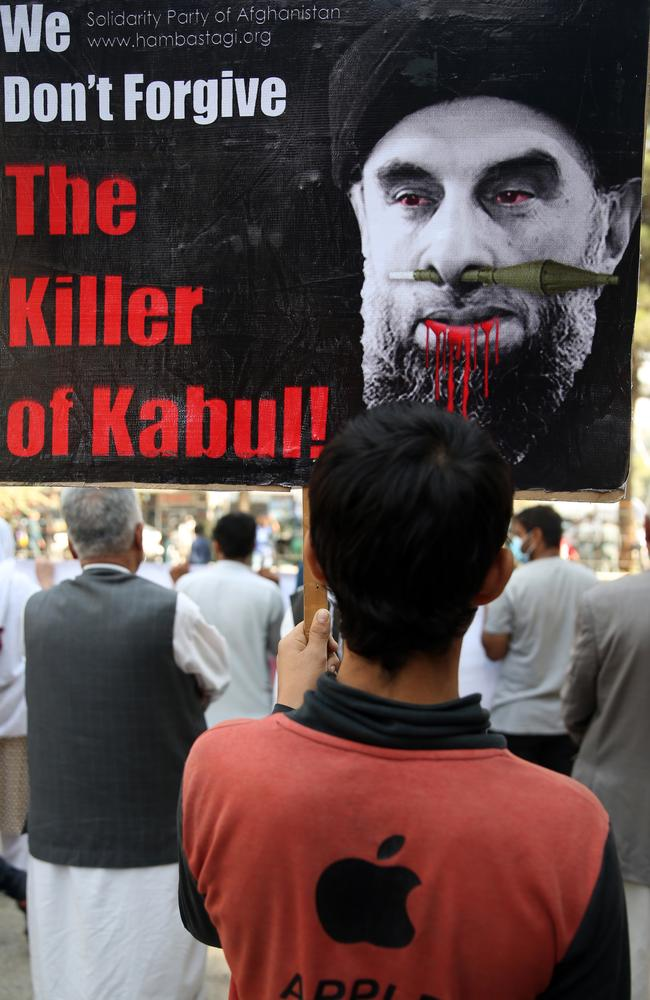 An Afghan demonstrator holds a placard with an image of Gulbuddin Hekmatyar during a demonstration against him in a public park in Kabul, Afghanistan last month. Picture: Rahmat Gul