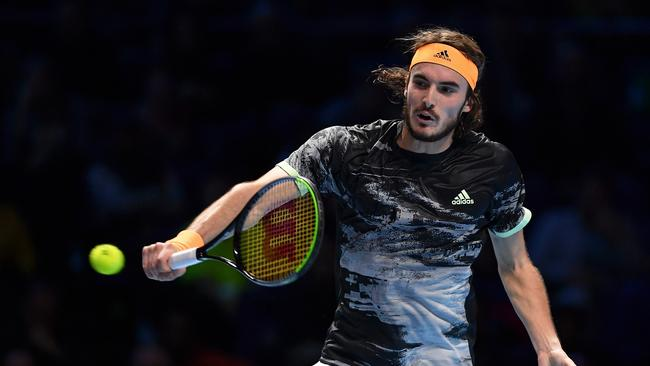 Stefanos Tsitsipas fires a backhand past Federer. Picture: Justin Setterfield/Getty