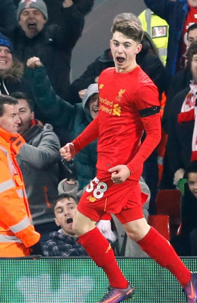 Liverpool's Ben Woodburn celebrates scoring his side's second goal.