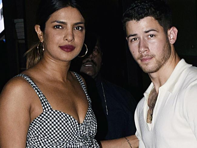 Priyanka Chopra (L) and US singer Nick Jonas stand together in Mumbai. Picture: AFP