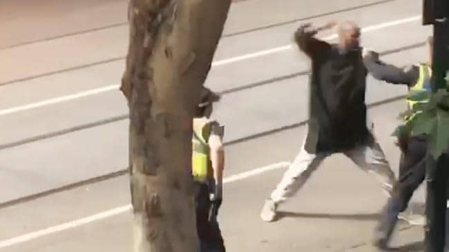 The moment before the terrorist was shot by police after a rampage in Melbourne's CBD. Picture: AAP