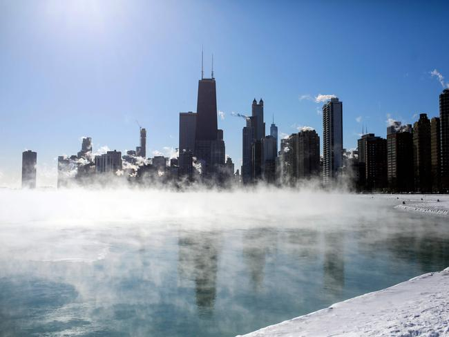 Steam hovers above Lake Michigan as 'instant frostbite' warnings were issued, flights grounded and schools and businesses closed. Picture: Joshua Lott / AFP