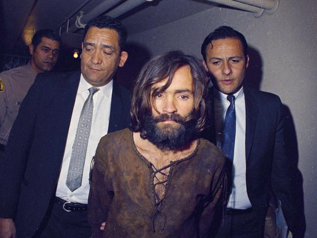 Charles Manson being escorted to his arraignment on conspiracy-murder charges in connection with the Sharon Tate murder case. Picture: AP