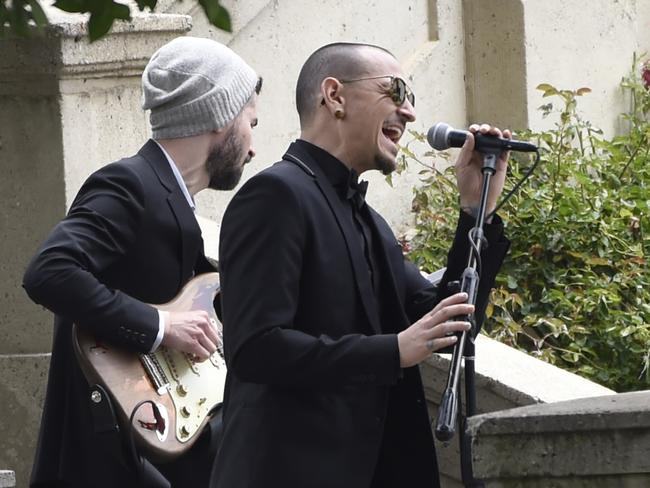 "Chester Bennington, of Linkin Park, performs ""Hallelujah"" at a funeral for Chris Cornell at the Hollywood Forever Cemetery in Los Angeles. Picture: AP"