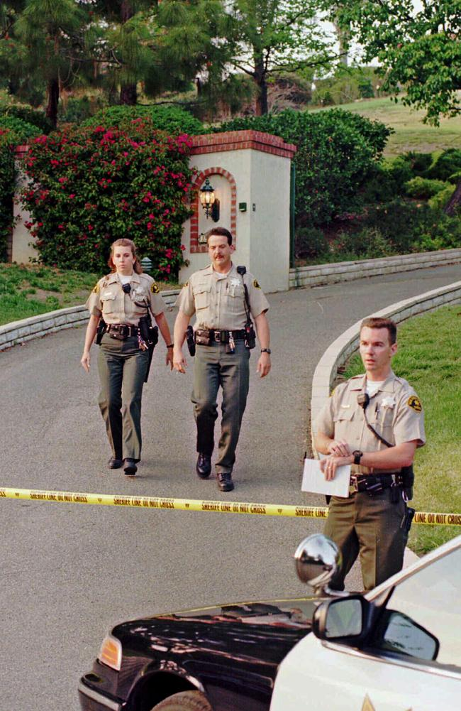 Police at the scene of the cult suicide in 1997.
