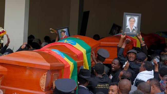Mourners and family members escort the coffins of the Ethiopian passengers and crew who died in the Ethiopian Airlines crash. Picture: Jemal Countess/Getty Images.