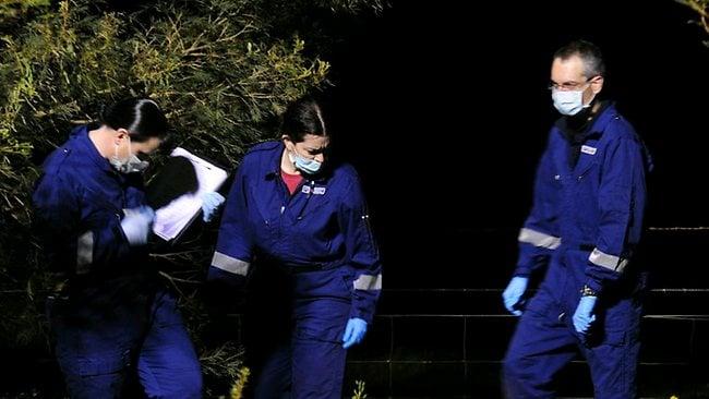 Investigators search the scene where Jill Meagher's body was found. Picture: Harman Stephen