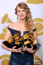 <p>Musician Taylor Swift poses backstage with her awards for Album of the Year, Best Female Country Vocal Performance, Best Country Song and Best Country Album at the Grammy Awards on Sunday, Jan. 31, 2010, in Los Angeles. (AP Photo/Mark Terrill)</p>
