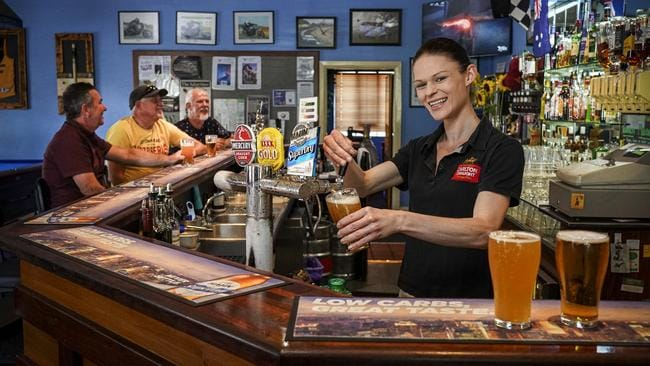 Lobethal Hotel Duty Manager Zoe Watkins serves in the main bar. Picture: AAP / Mike Burton