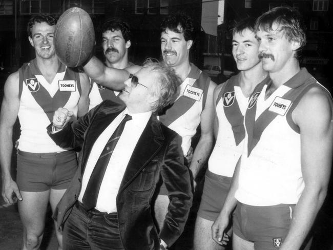 Footy fan ... businessman Dr Geoffrey Edelsten with members of the Sydney Swans after buying the Australian Rules team in the 1980s.