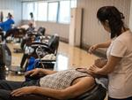 A man is shaved at a salon in the Munsu Water Park complex on August 19, 2018 in Pyongyang. Picture: Carl Court/Getty Images