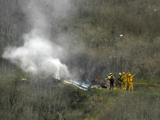 Firefighters work the scene of a helicopter crash where former NBA star Kobe Bryant died. (AP Photo/Mark J. Terrill, File)