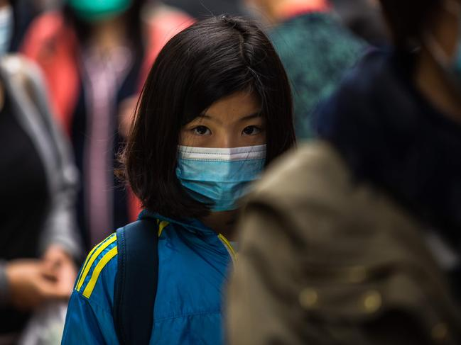 People wearing protective face masks in Hong Kong. Picture: Dale De La Rey/AFP