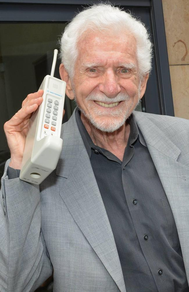 Businessman and inventor of the first cellular phone Martin Cooper holding the Motorola Dynatac phone he invented.