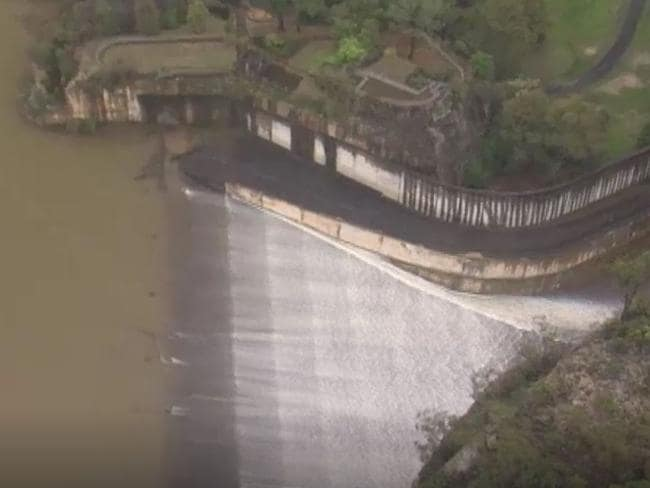 Footage shows water rushing out of the overflowing dam. Picture: ABC