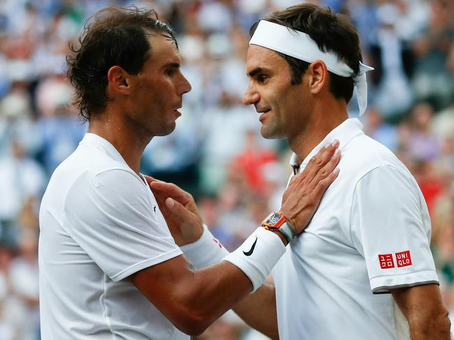 Roger Federer and Rafael Nadal both have vast property portfolios. (Photo by Adrian DENNIS)
