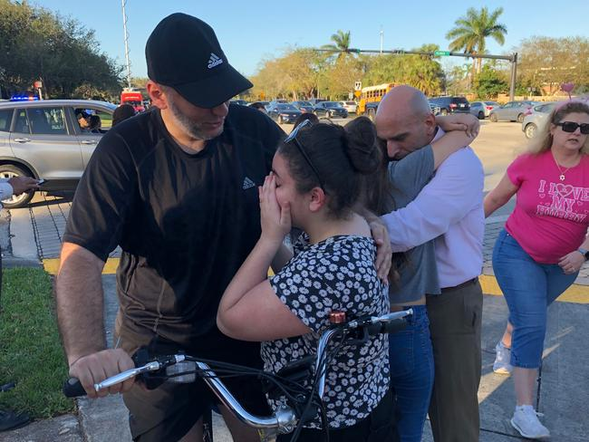People react at Marjory Stoneman Douglas High School in Parkland, Florida. Picture: AFP
