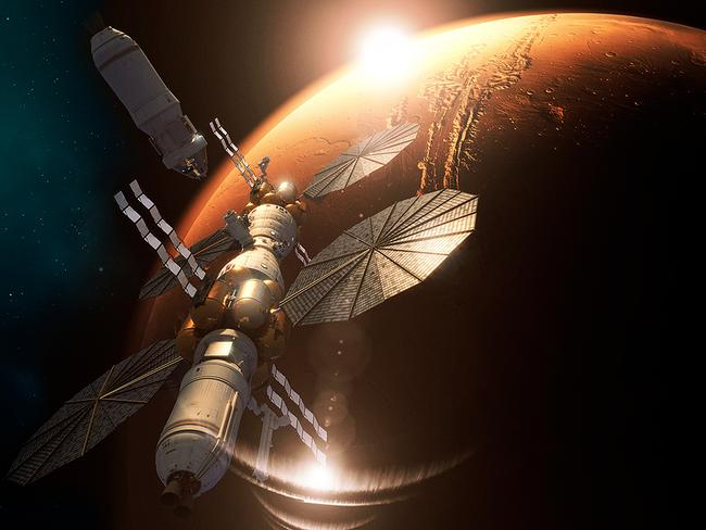 A conceptual image supplied by Lockheed Martin showing its proposed Mars Base Camp mission to establish a station in orbit above the Red Planet to facilitate landers exploring the surface below.