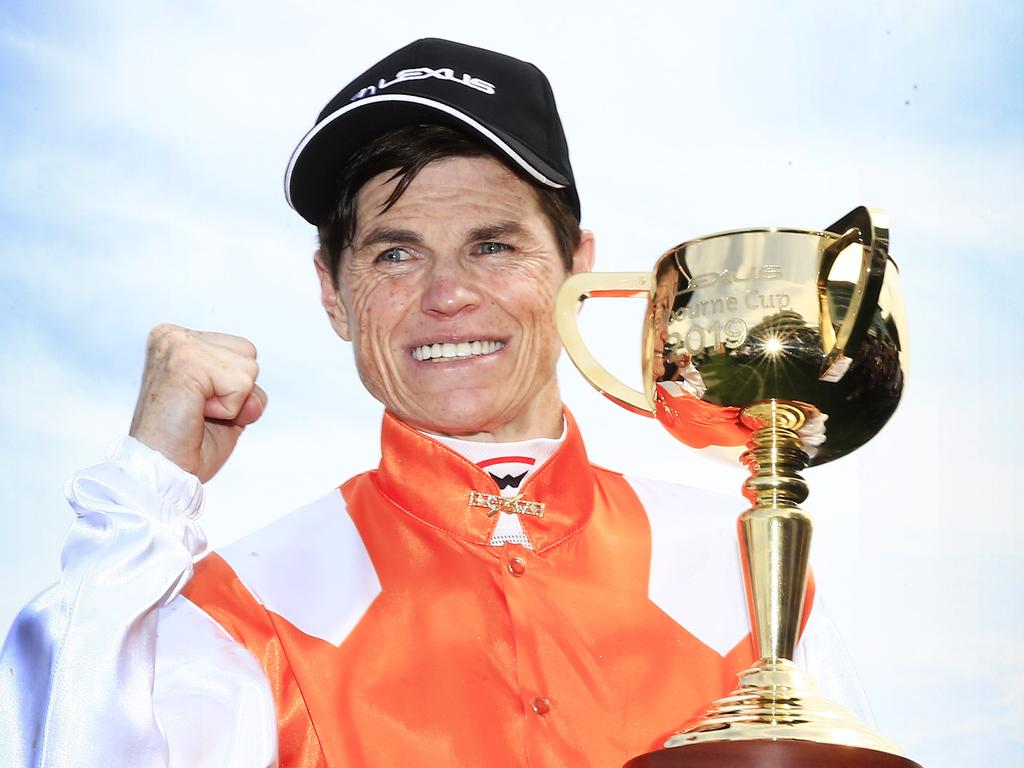 Craig Williams holds the Melbourne Cup after winning with Vow And Declare.