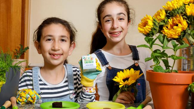 Abbey Qasabian, 8, and Ariel Qasabian, 10, from Frenchs Forest in NSW starting their sunflower gardens. Picture: Dallas Kilponen