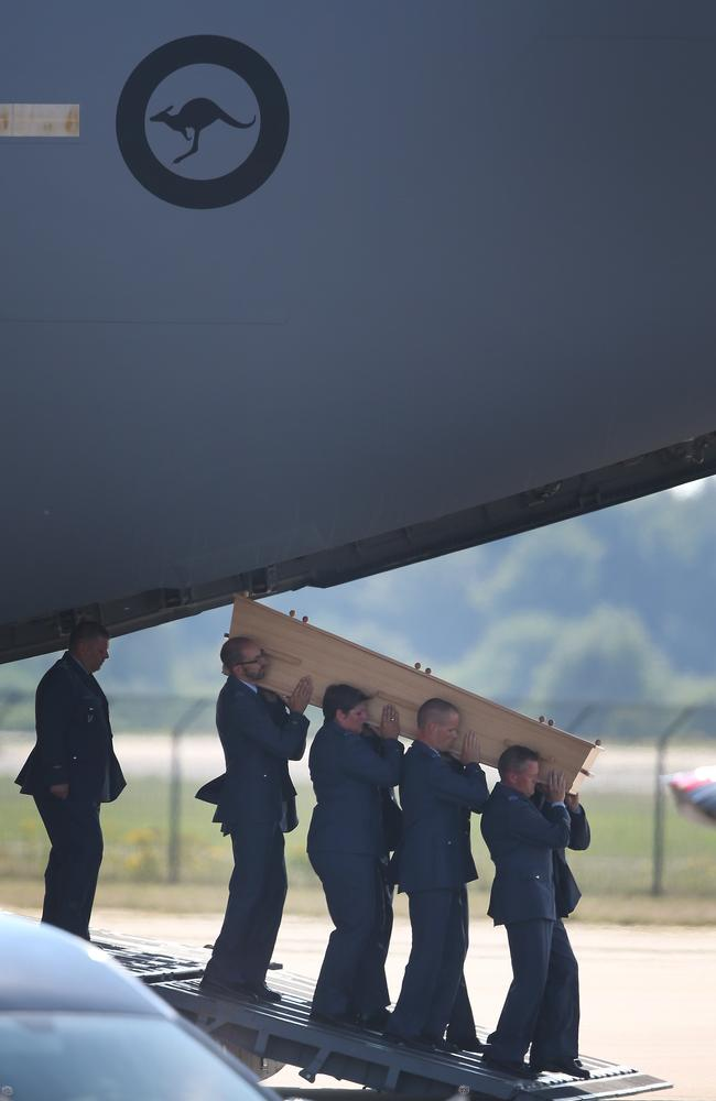 Arrival ... Dutch military personnel carry a coffin containing an unidentified body from the crash of Malaysia Airlines flight MH17 from a Royal Australian Air Force C47 to a waiting hearse.