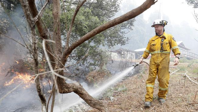 A back burn at the top of Donnellys Rd, Geeveston, to protect a house. Picture: RICHARD JUPE
