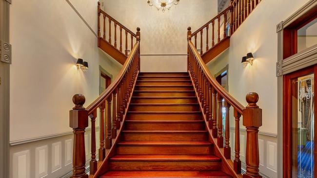 A grand staircase leads to the upper level.