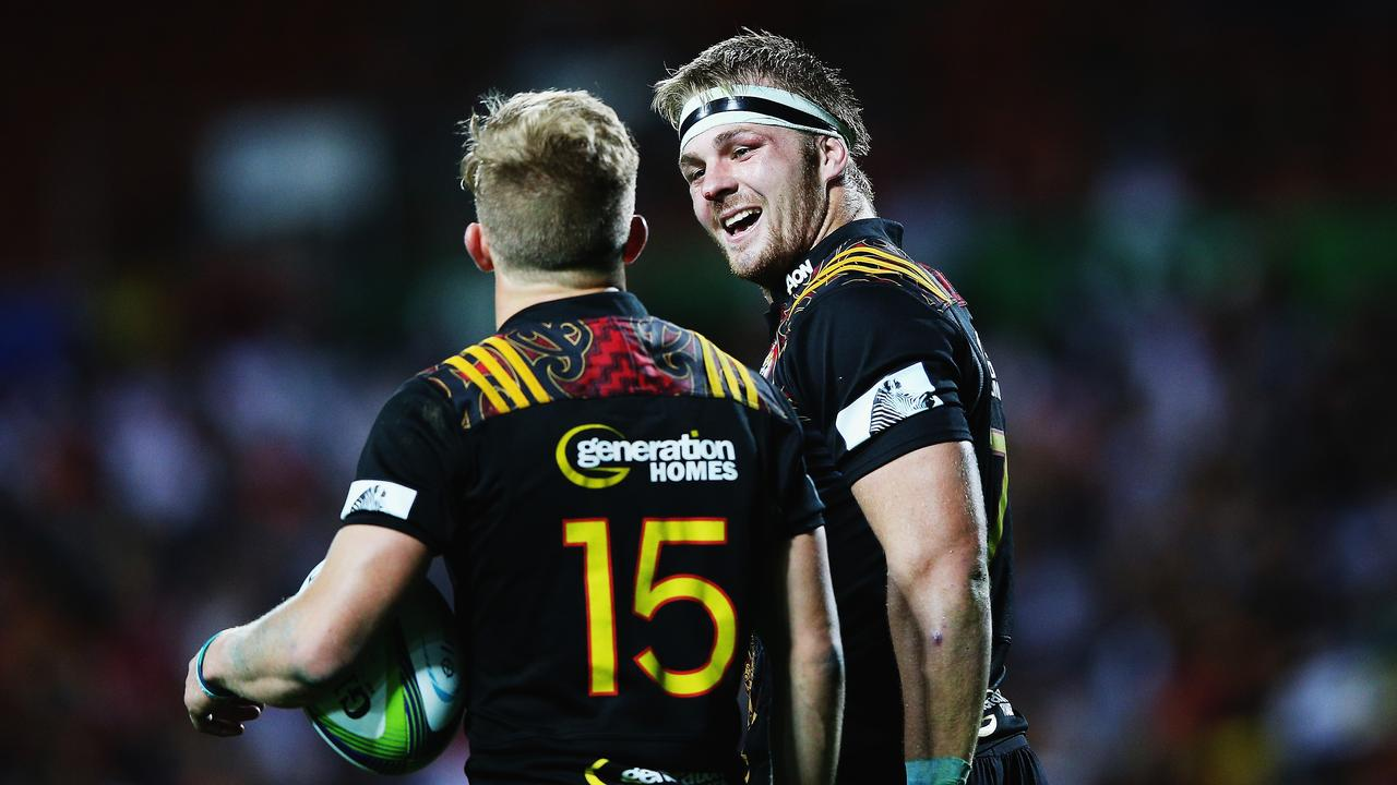 Damian McKenzie of the Chiefs celebrates with Sam Cane after scoring a try in Hamilton.