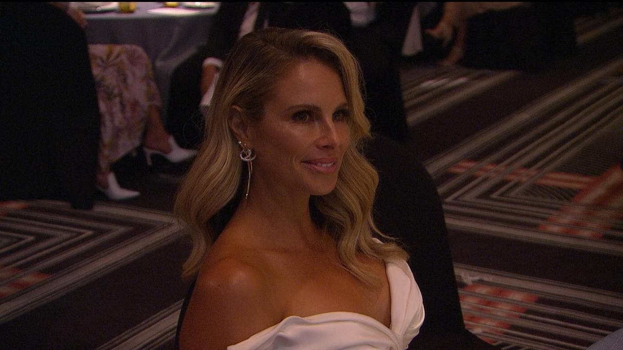 Proud wife Candice Warner watching David accept his award.