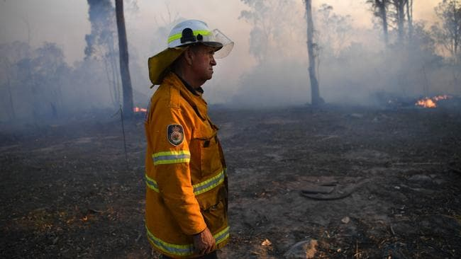 NSW Rural Fire Service volunteer Bob Kneipp successfully defends a property in Torrington, near Glen Innes. Picture: AAP