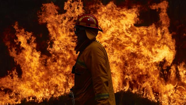 A Country Fire Authority member works on controlled back burns. Picture: Brett Hemmings/Getty Images