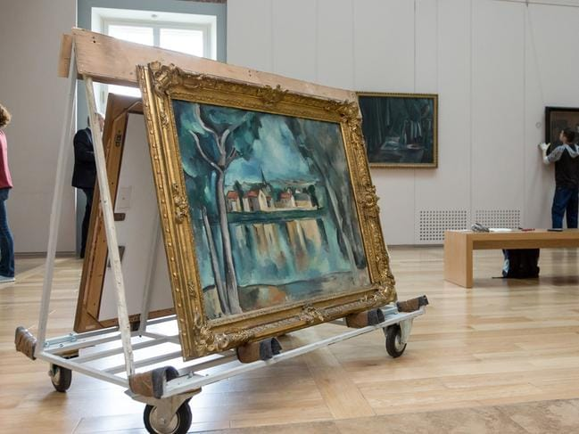 At The State Hermitage Museum in St Petersburg, Russia, pictures are removed from the walls to be sent to Sydney. Picture: The State Hermitage Museum, 2018/Svetlana Ragina