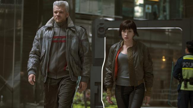 Pilou Asbaek, left, and Scarlett Johansson appear in Ghost in the Shell.