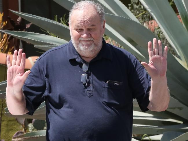 Thomas Markle dropped off flowers at Meghan's mother's home days before the royal wedding. Picture: Rachpoot/MEGA
