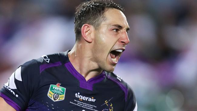 Billy Slater celebrates a try in the grand final.