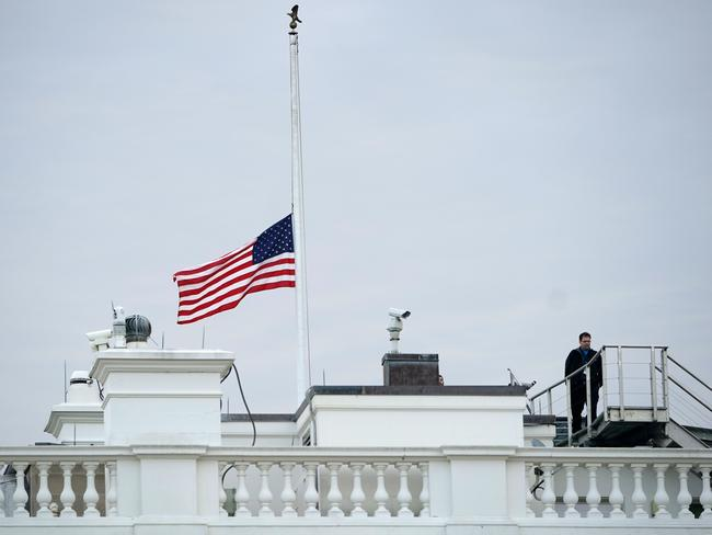 The flag above the White House flies at half staff after an order by US President Donald Trump. Picture: AFP