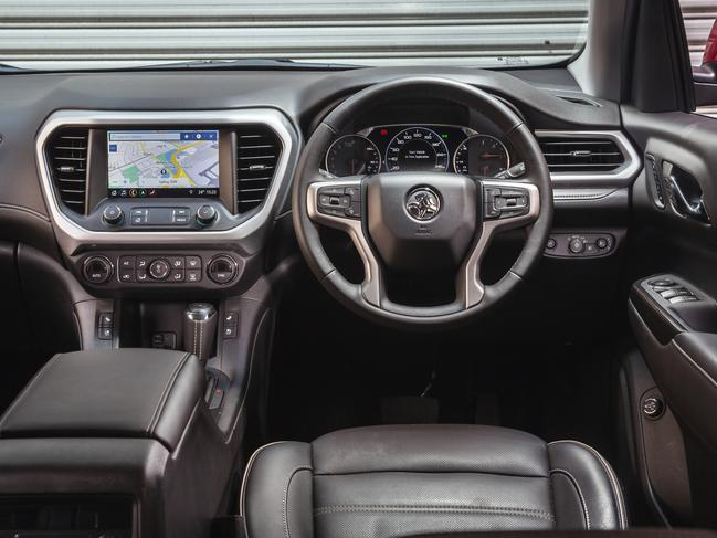 Acadia controls: Hi-res screen, digital speed display plus heated seats and two sunroofs.