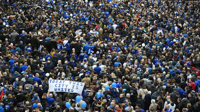 "People gather in Jubilee Square to take part in the ""Vichai March"", or the ""5000-1"" march"