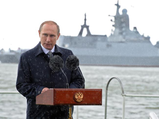 Russian President Vladimir Putin delivers a speech under the rain during celebrations for Navy Day in Baltiysk in the Kaliningrad region. Picture: AFP