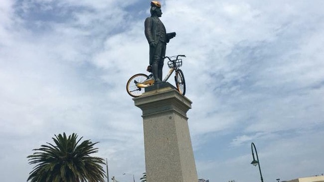 … on top of public statues … Picture: Facebook/OBikes in unusual places