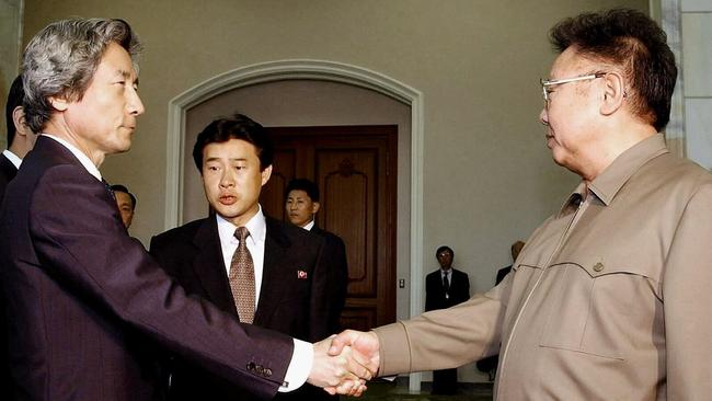 Japanese Prime Minister Junichiro Koizumi shakes hands with North Korean leader Kim Jong-Il on this day in 2002.