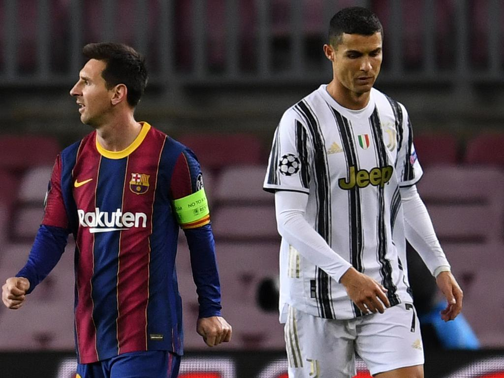 BARCELONA, SPAIN - DECEMBER 08: Lionel Messi of Barcelona (L) and Cristiano Ronaldo of Juventus F.C. (R) look on during the UEFA Champions League Group G stage match between FC Barcelona and Juventus at Camp Nou on December 08, 2020 in Barcelona, Spain. Sporting stadiums around Spain remain under strict restrictions due to the Coronavirus Pandemic as Government social distancing laws prohibit fans inside venues resulting in games being played behind closed doors. (Photo by David Ramos/Getty Images)