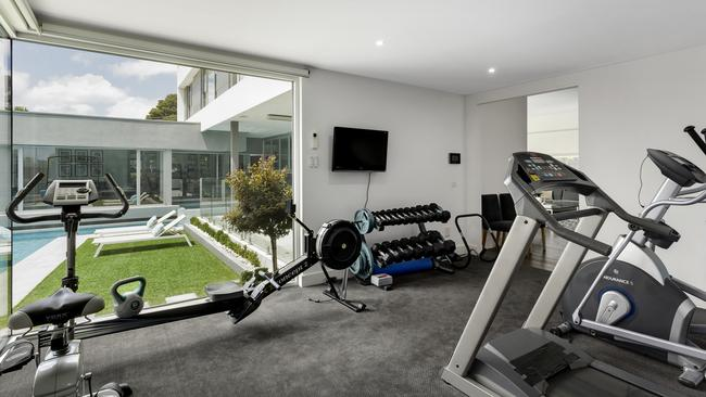 The gym overlooks the pool.