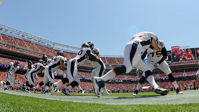 The Denver Broncos warm up at San Francisco's new stadium.