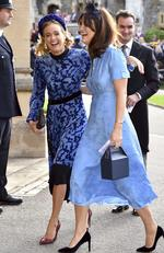Cressida Bonas, left, arrives for the wedding of Princess Eugenie of York and Jack Brooksbank at St George's Chapel, Windsor Castle, near London, England, Friday Oct. 12, 2018. (Matt Crossick/Pool via AP)